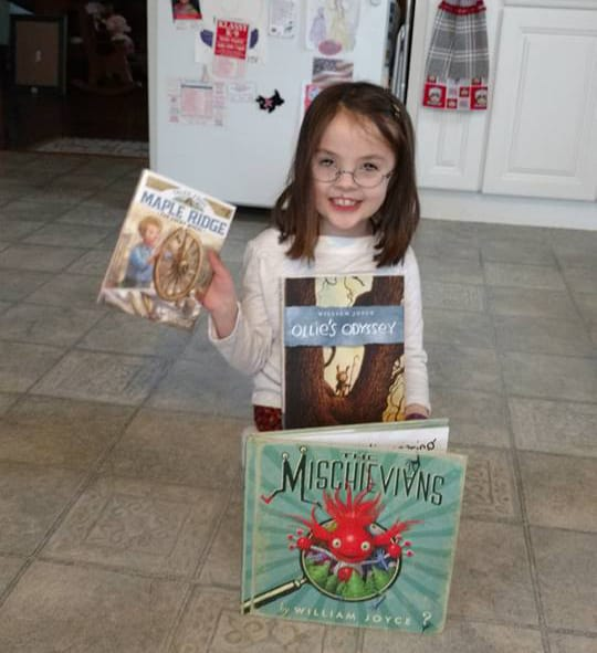 Big reader smiling with Picture books and Easy readers